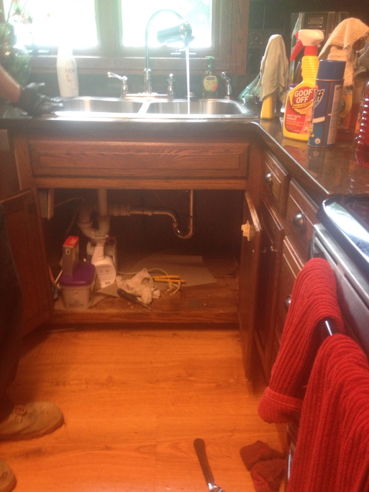 Remove garbage disposal under kitchen drain and re-pipe sink waste to existing drain