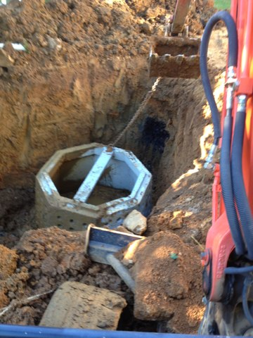 Install new dry well for septic system.