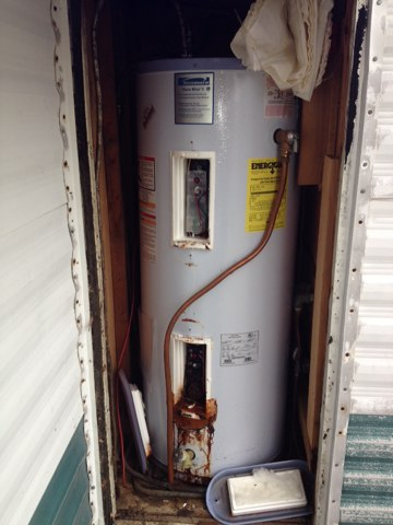 Install new 40 gallon electric water heater in mobile home.