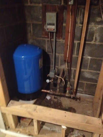 Install new well tank with new pressure switch and gauge. A sure sign of a bad well tank is a fluctuations  in water pressure and a clicking sound in the basement.