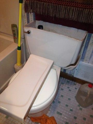 Replace broken toilet