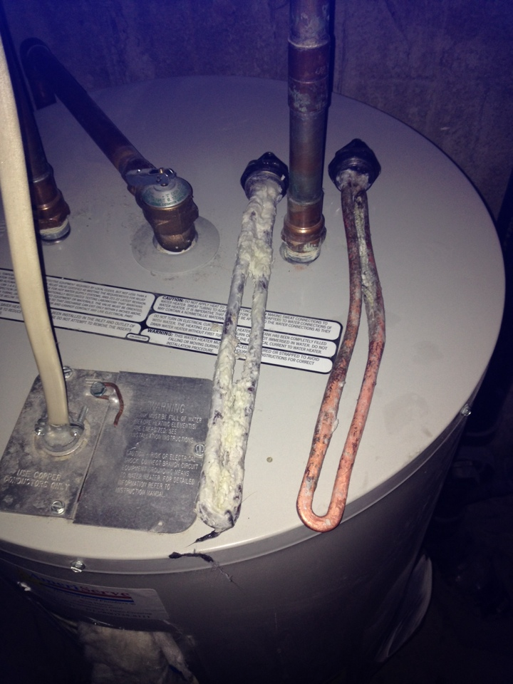 Replace two electric elements to water heater. Hard water will cause your water heater to fail pre maturely.