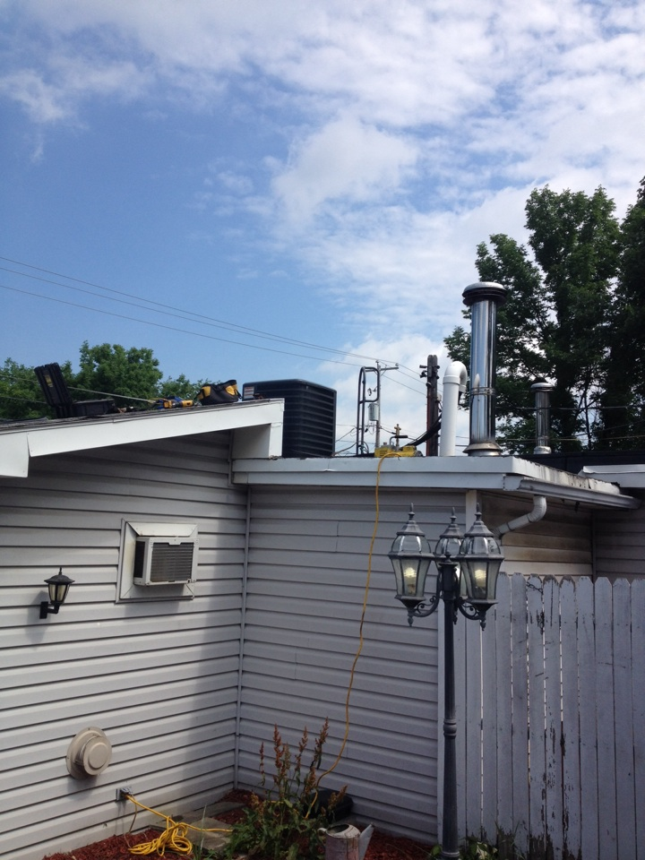 Ameriserve One Hour heating and air installing Air Conditioner on roof of local business