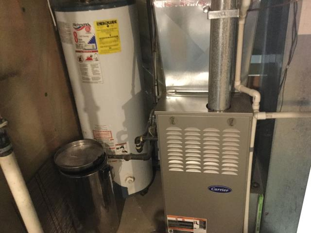 Libertyville, IL - 8 year old Carrier furnace cleaning along with satisfaction guaranteed dryer vent cleaning in Libertyville by Approved Comfort!