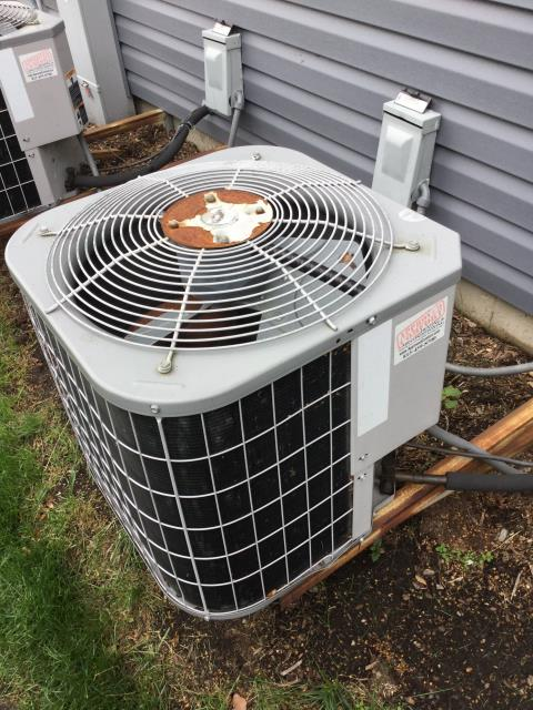 Huntley, IL - Performing air conditioner cleaning on 2 14 year old carrier units