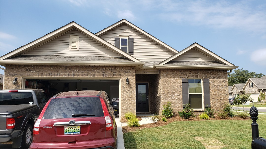 Madison, AL - At a customers house in Madison,AL  looking to have gutter added on both sides and the back, call Ridgeline Construction for your free estimate!