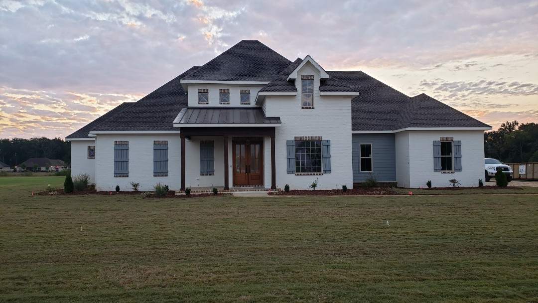 Athens, AL - At this beautiful new house in Athens,AL that Ridgeline Construction did the shingles, metal roof, James Hardie trim, built the shutters, and will be putting gutters on next week, call Ridgeline Construction for all your exterior needs.