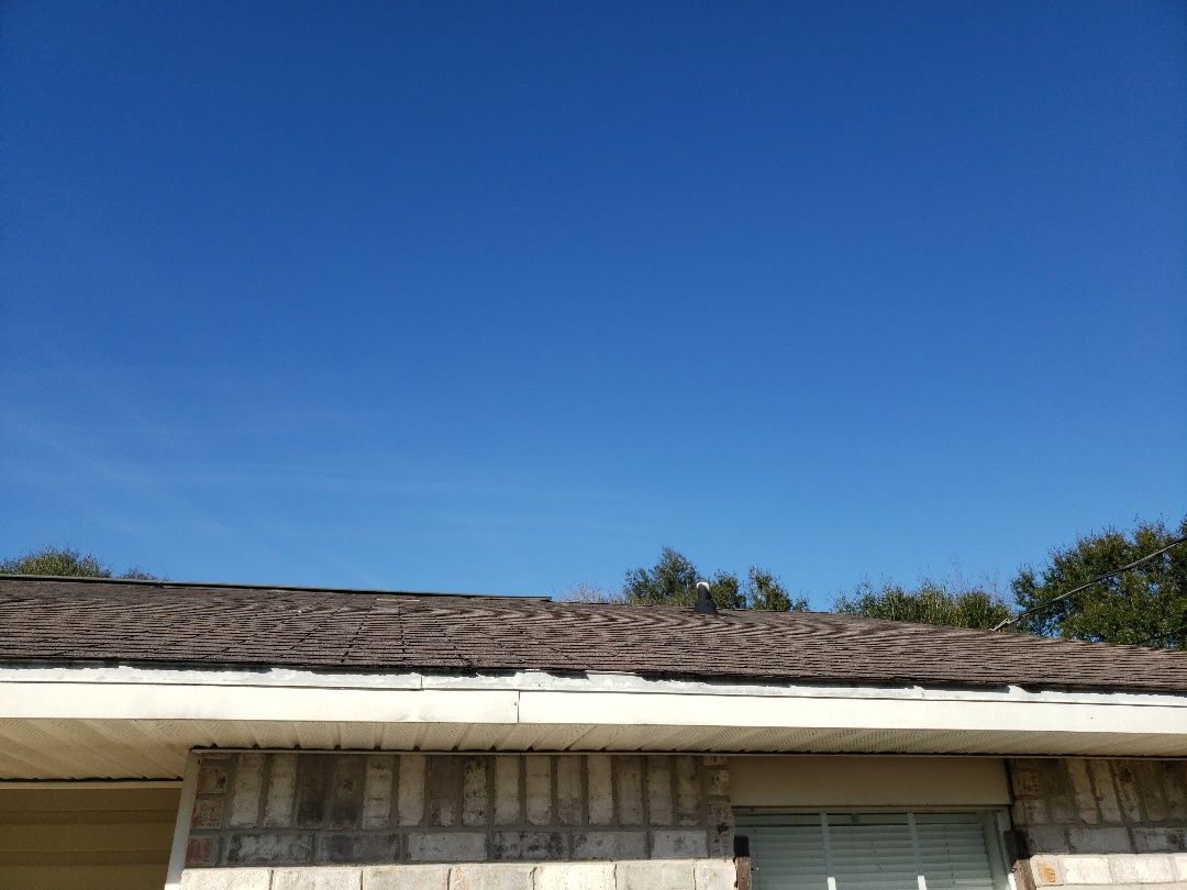 Milton, FL - All the signs of needing roof replacement. Broken shingles, granule loss, loose ridges and tarred vent pipe evidencing a leak in the PVC boot.