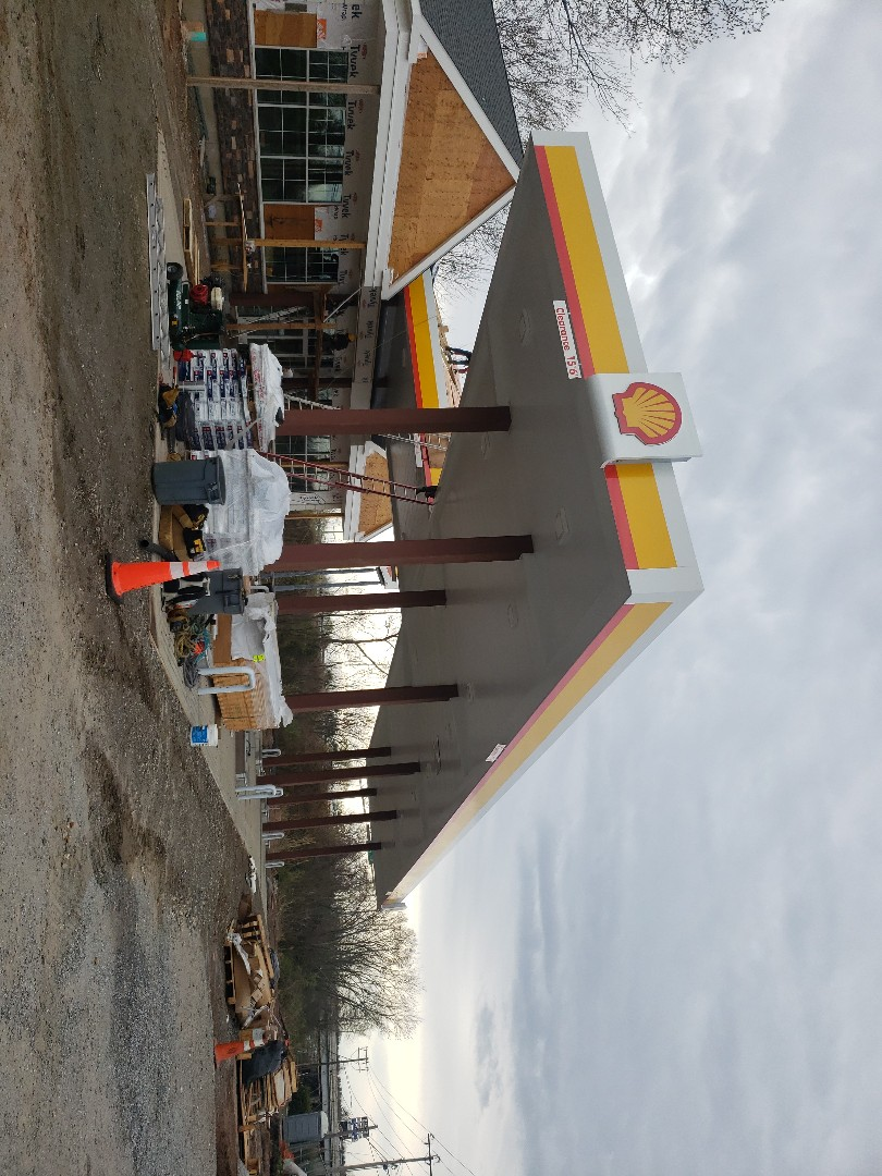 Rocky Hill, CT - Installing a Timberline HDZ roof system on this New Construction Gas Station....Vnanfito Roofing and siding is your #1 roofing contractor for residential and commercial services
