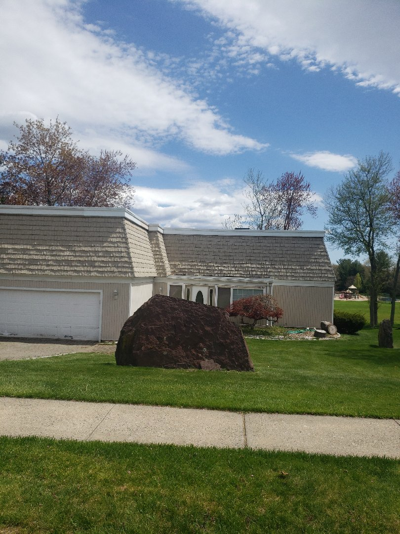 Wethersfield, CT - Quoting a flat rubber roof repair on this contemporary home!!