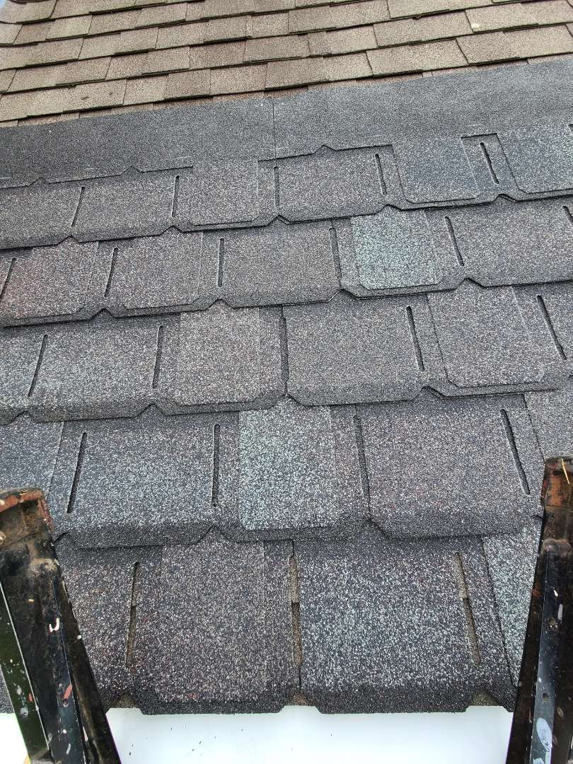 """Southington, CT - Customer wants options! Setting up a display of GAF Camelot shingles on the roof for a customer. """"Timeless beauty with uncompromising performance."""""""