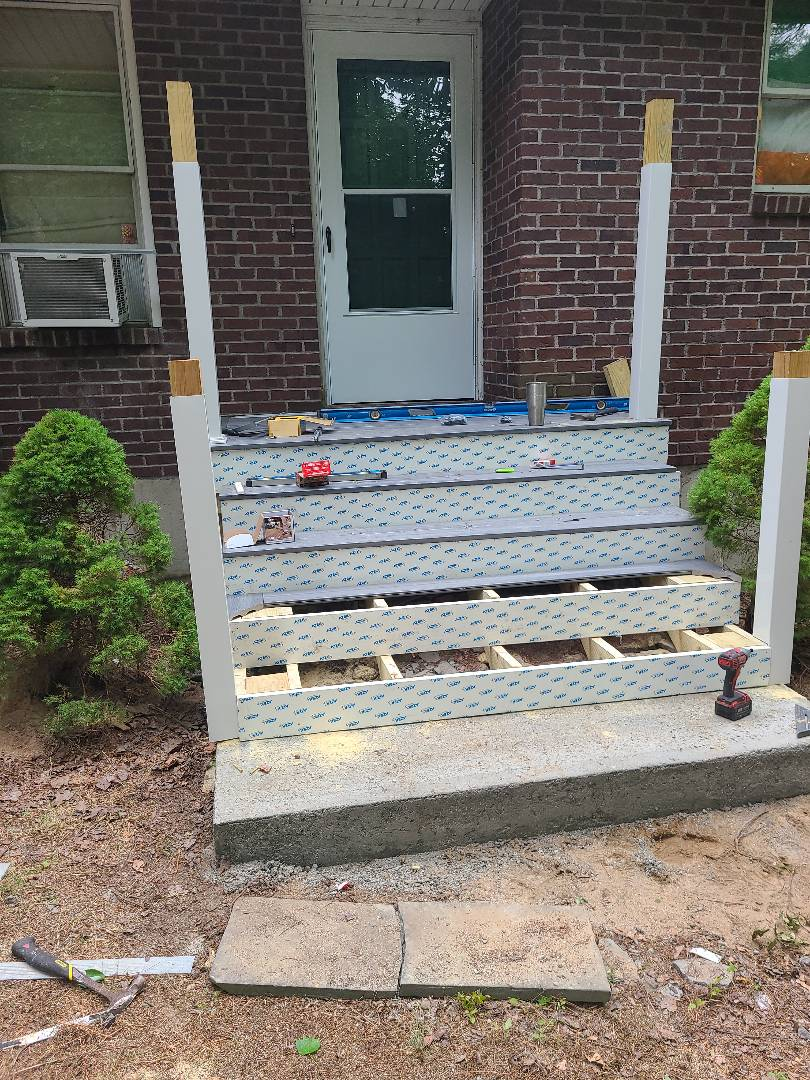Farmington, CT - New combination storm door. New azek deck over an existing set of cement steps. New colorgaurf railing system. Lical contractor, call today for a free estimate.