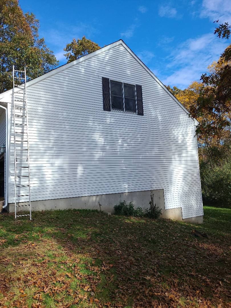 Milford, CT - New vinyl siding, plywood and house wrap after a tree.hit this house!