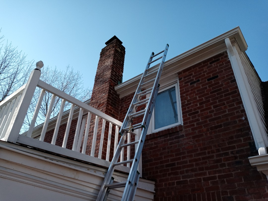 Middletown, CT - Chimney flashing leak occurring on this house in Middletown Connecticut. Original copper flashing was fine on the second tier. Aluminum flashing was installed on lower tier.