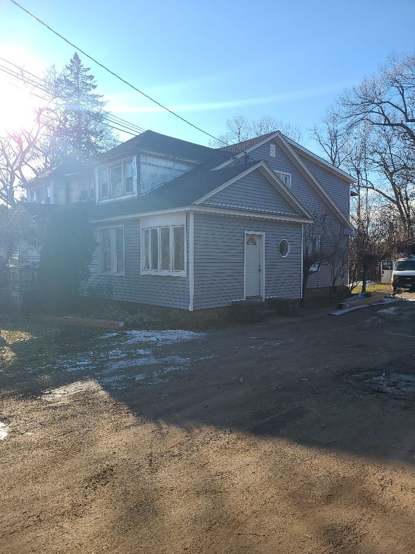 """North Haven, CT - Stay tuned for this homes new face lift...new Exterior portfolio Vinyl Siding and 5"""" seamless gutters"""