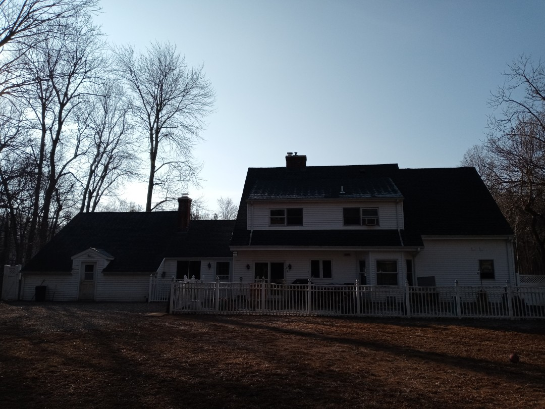 Cheshire, CT - A new roofing system on the detached garage as well as applying zinc shield to the rear of the home and detach shed on this project in Cheshire Connecticut.