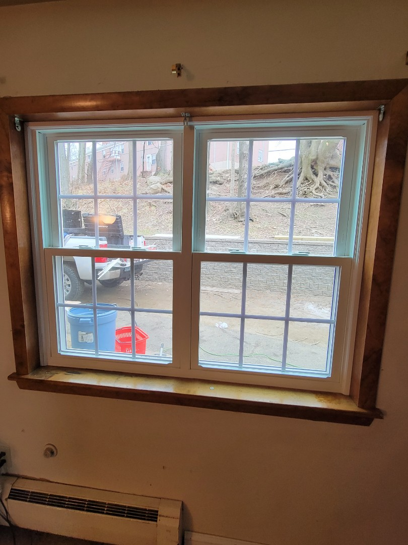 Stamford, CT - Interior trim for the new vinyl replacement windows.  Call vanity roofing and siding today for a free estimate on any of your home remodeling needs