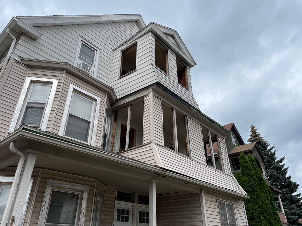 New Britain, CT - Prepping to remove the two upper porch areas