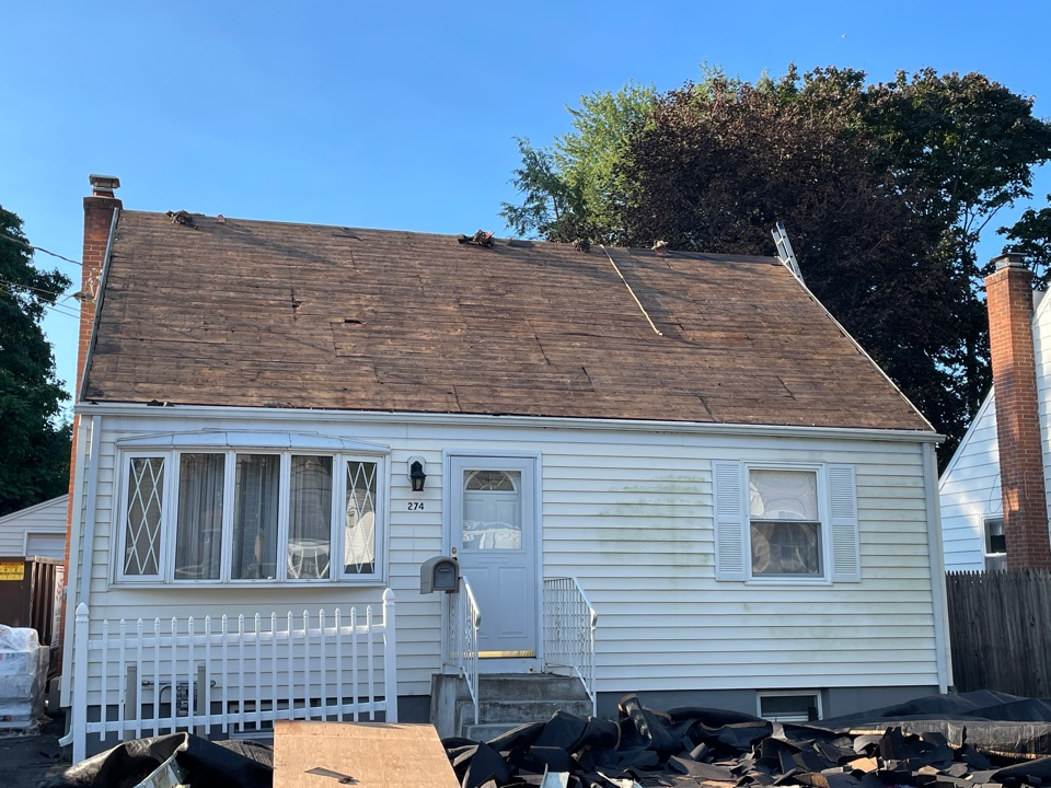 New Britain, CT - Stripping shingles for a roof replacement in New Britain
