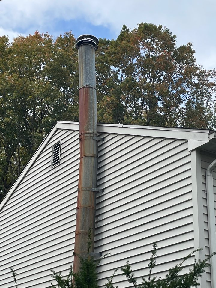 Wallingford, CT - Removing and old chimney pipe and repairing the damage