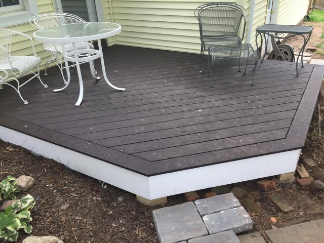 Cheshire, CT - On this Cheshire home we replaced siding and removed and installed a new pressure treated deck.