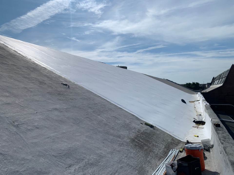 Baltimore, MD - Replacing section of commercial roofing in Baltimore with mew Mule Hide TPO