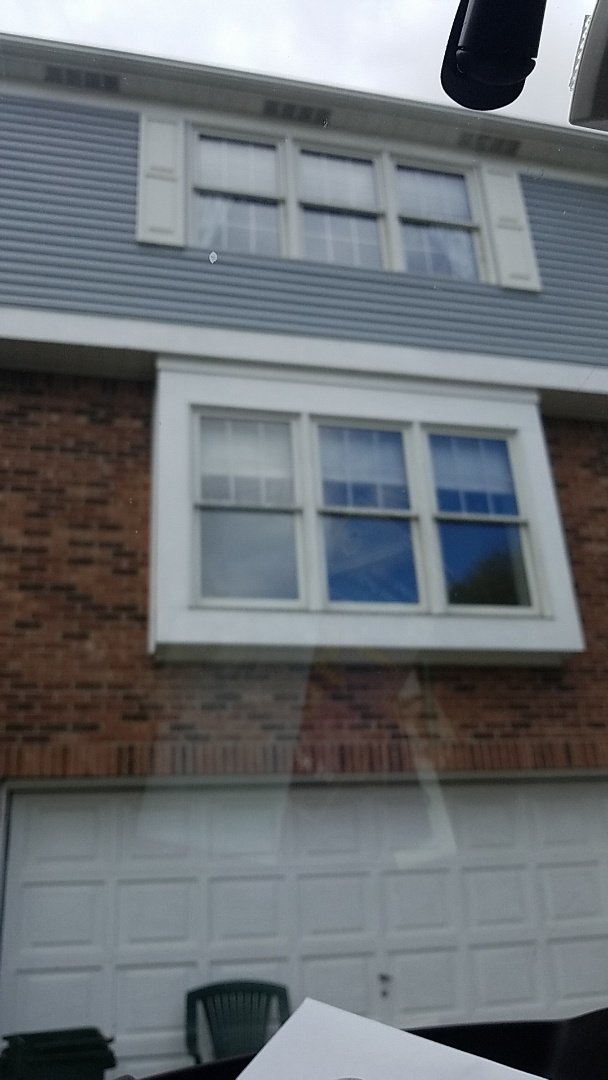 Coraopolis, PA - Cleaning gutters and installing gutter guards.