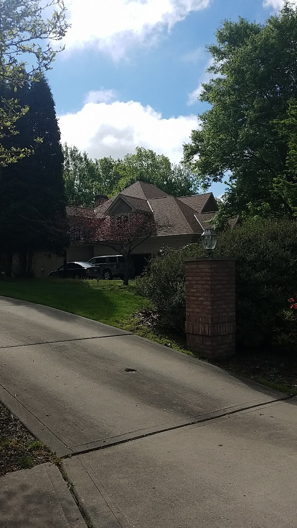 Wexford, PA - Investigating black downspouts. Replacing missing ridge cap.