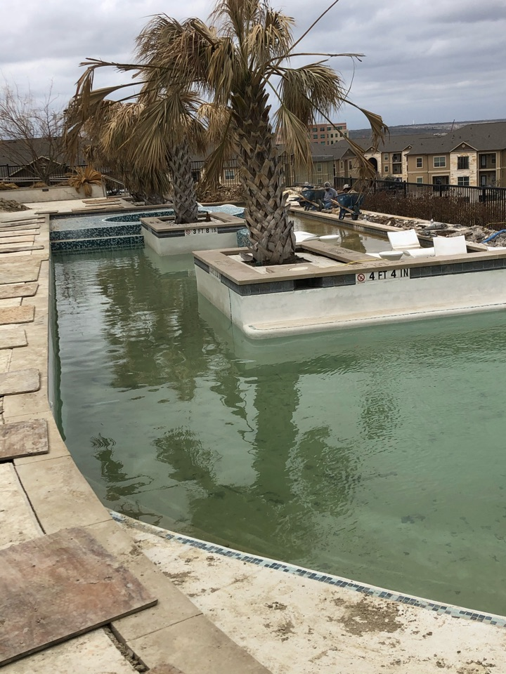 Round Rock, TX - We're continuing an interesting foundation repair project on an apartment pool. It sits on a slope and we are using steel piers to stabilize it. This week we've been draining the pool and will continue the pier installation and repairs!