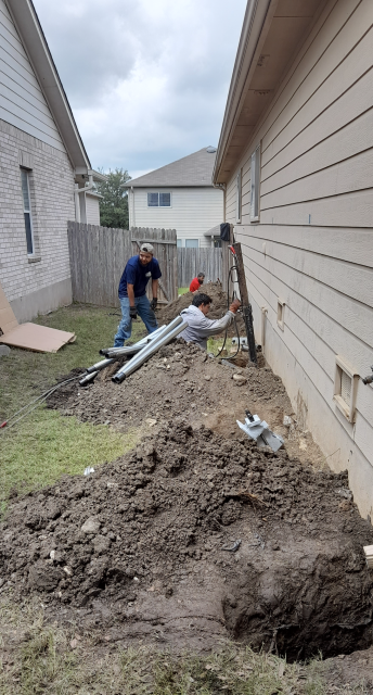 Converse, TX - Continuing our foundation repair and pier installation for Ms. Ingalls today. There are a few holes dug already with some of our steel piers already being pushed until they hit bedrock.