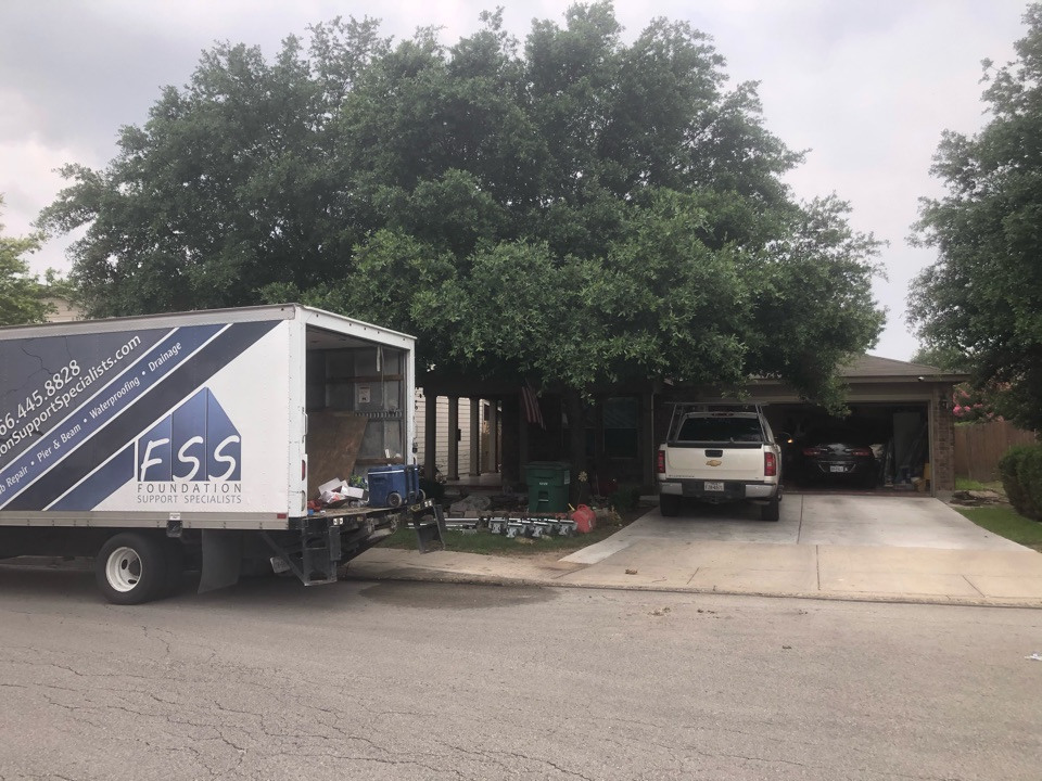 San Antonio, TX - Starting a new foundation repair project today for Mr. Vela. His house is settling in the front, so we'll install 18 steel piers to stabilize his house.