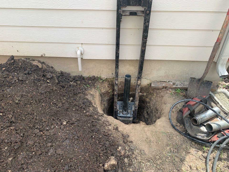 San Antonio, TX - Starting the next foundation repair project today for our customer. We will install 9 steel piers to correct the settlement. We've already removed some of the landscaping to install some of the piers.