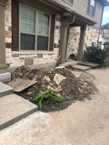Austin, TX - Working on a long-term foundation repair project at the Brodie Heights apartments. We've been repairing several of their units. The production of this foundation repair project is already underway and you can see where we have holes dug and being prepared for the steel pier installations.