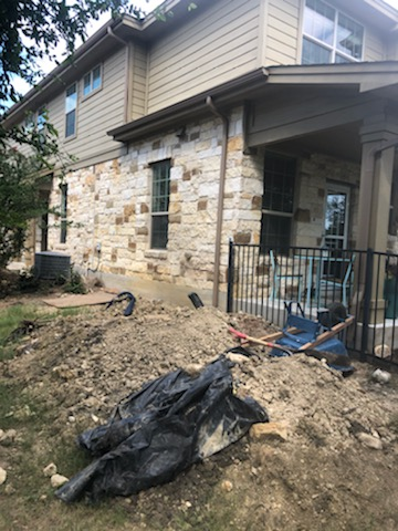 Austin, TX - In the middle of digging holes to install piers for this until at Brodie Heights Condominium Community. This foundation repair project will continue over the next few weeks. Our steel piers hit bedrock to stabilize and lift foundations, so these residents won't have to worry about foundation settlement for years to come!