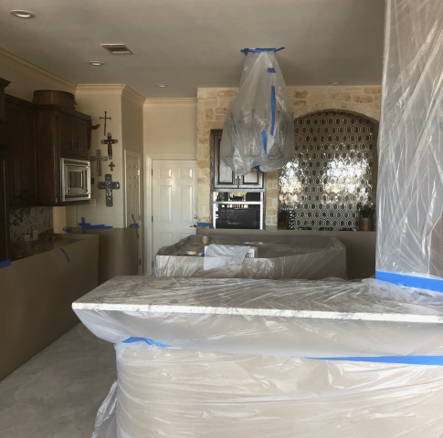 We finished covering up most of our customers furniture and decor to protect it from the debris caused by the breakouts. This foundation repair project requires a complete stabilization, so we're installing plenty of the steel piers inside the house.
