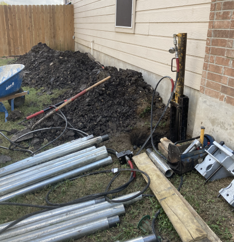 We're all set up here and ready to install steel piers for this foundation repair project. The homeowner noticed that the windows and entry doors were not opening properly and getting stuck. We'll install 8 steel piers to correct this issue and end the foundation settlement.