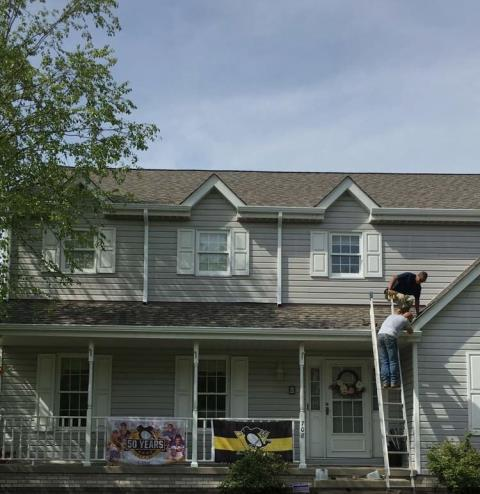 Cranberry Township, PA - Finishing up New CertainTeed Lifetime roof replacement, Landmark Pro Weatherwood Shingles, installed new Alcoa seamless gutters and downspouts, and installed new SunTech skylight.