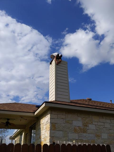 Pflugerville, TX - Roof replacement and chimney siding repair