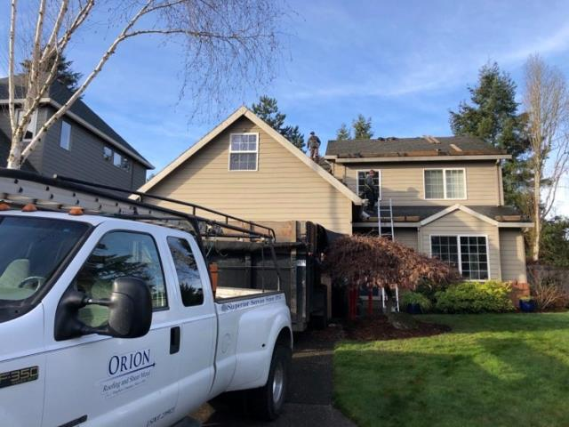 Tigard, OR - Orion Roofing's residential steep stope crew just started tear-off on this beautiful home in Tigard.