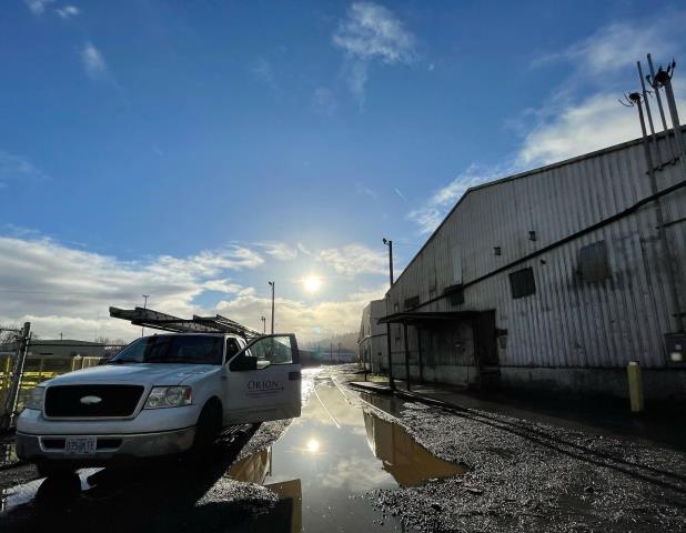 Portland, OR - Working on a commercial metal roof repair today .The sun is starting to shine through and dry up the rain.