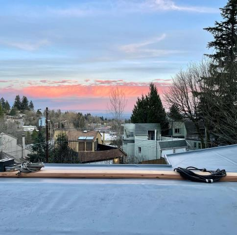 Portland, OR - Orion Roofing and Sheet metal is working on installing IB Roof Systems 50 mil IB roof membrane. Check out the beautiful sky that was captured by the foreman from working on the rooftop