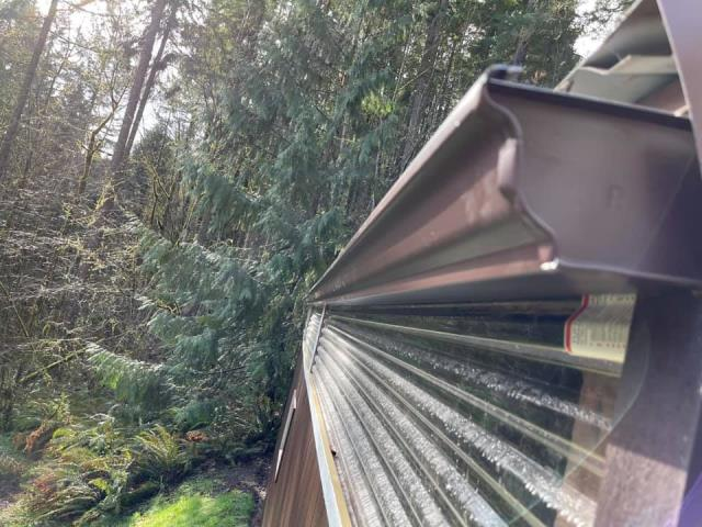 Hillsboro, OR - Installing new continuous gutters and new downspouts on a pole building / shop in Hillsboro. Same shop we installed a  metal roof on in 2019.