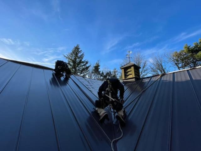 """Portland, OR - Our metal roofing crew is making some great progress on this metal roof installation.  Here are pictures of them beginning installation of a new standing seam metal roof in Portland.  Metal Profile: 16""""  snap lock panels in 24 gauge steel with Kynar paint"""""""