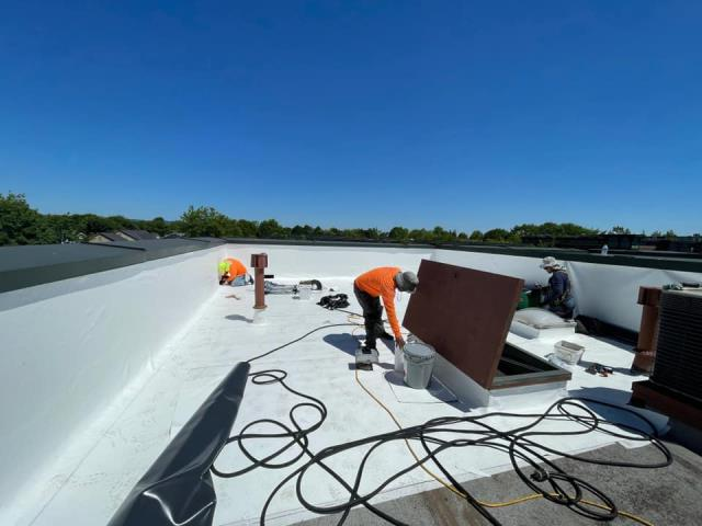 Hillsboro, OR - Our low slope roofing crew is currently installing IB Roof Systems PVC roof assembly in white.