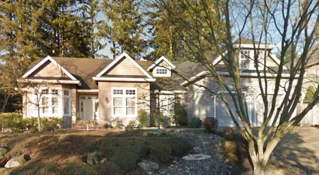Lake Oswego, OR - Gutter repair on a residential shingle roof in Lake Oswego