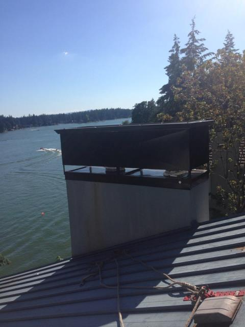 Lake Oswego, OR - We just finished installing this custom made chimney cap for this roof in Lake Oswego. Check out the view!