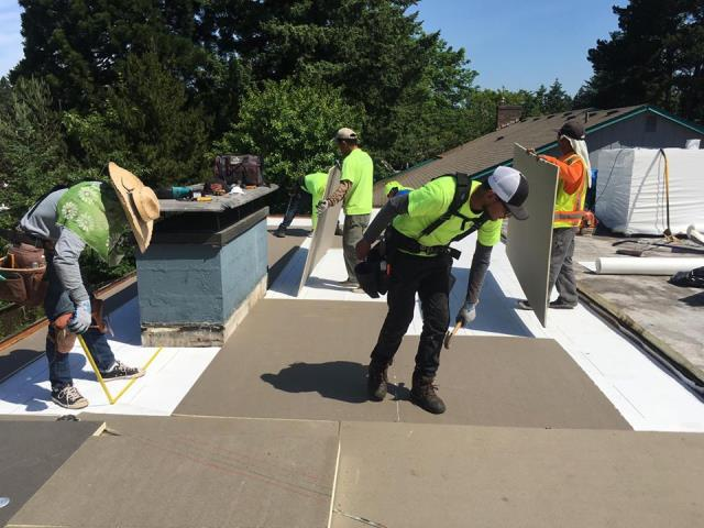 Portland, OR - Orion Roofing and Sheet Metal is working on installing a flat roof in SW Portland. IB Roof Systems