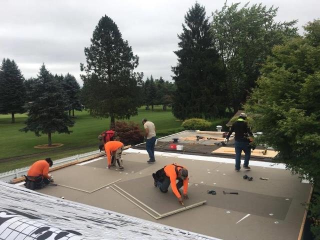 Portland, OR - Orion Roofing's low slope roof department is installing IB Roof System's 50 MIL PVC on this home in NW Portland.