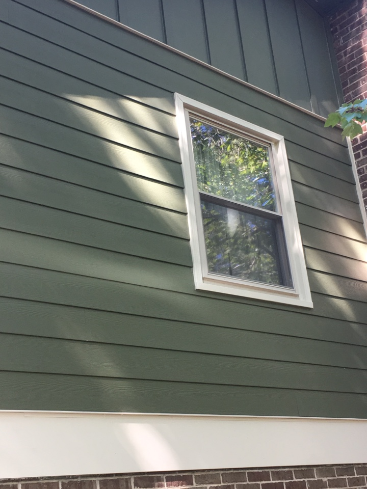 Midlothian, VA - Board and batten James Hardie panels tying into prepainted HardiePlank Lap siding in Midlothian.