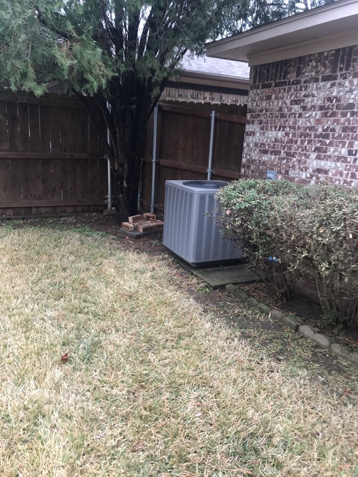 Servicing a ruud heat pump for a family and Irving